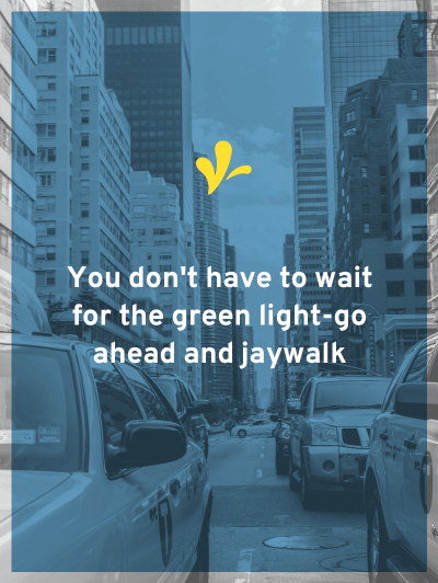 Guess what, you don't have to wait for the green light - go ahead and jaywalk. Look both ways and start walking across the intersection.